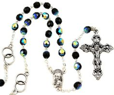 """Wedding Rings Italian Rosary, 7mm black crystal beads. Imported from Italy. Simple approximate conversion: 4/5mm = 3/16"""", 6/7mm = 1/4"""", 8mm = 5/16"""", 10mm = 3/8"""". Fabulous wearable wedding gift. 7mm Black crystal beads with wedding rings as Our Father beads. An oxidized Mother & Child center and 2"""" oxidized crucifix complete this unusual rosary. This rosary has an inner circular length of approx. 30 inches, so it may also be worn!"""