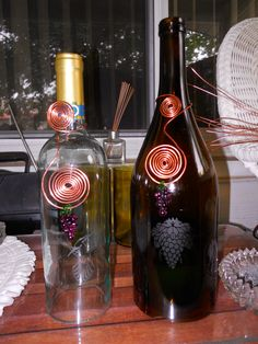 Two more wine bottles small one is a hanging candle holder still working on the insides other is half gallon table top bottle goes over candle