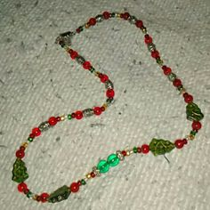 Glass bead necklace Pretty glass n metal beads. Holiday piece. (Features Xmas trees) and holiday COLORS Made With Love Jewelry Necklaces