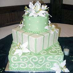 light green and white cake with sugar flowers