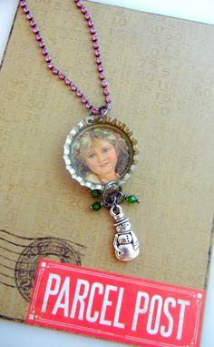 Easy DIY gifts - custom bottle cap pendants on rhinestone chain.
