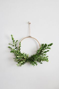 how to make your very own simple foliage wreathes to hang proudly on the wall or front door. What You'll Need An embroidery hoop (or Foliage Secateurs to trim foliage Green Florist Tape Fishing line Yarn to hang Christmas Diy, Christmas Wreaths, Christmas Decorations, Christmas Ornaments, Embroidery Hoop Decor, Embroidery Ideas, Etsy Embroidery, Simple Embroidery, Navidad Diy