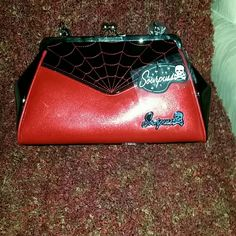 Purse Patent leather rock a billy pin-up type purse with nice embroidered spider web pattern. My pictures do no justice. The red is slight metallic snap closure 1zippered pouch 2 open like pouches on interior Brand new just got it from Baltimore Tattoo Convention as a gift but not my style cool bag though sour puss Bags Satchels