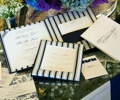 Papers used to print the wedding programs, schedule and table assignments coordinate with the white and navy blue theme.