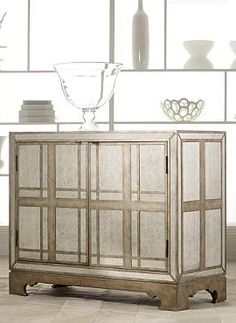 Add glamour to your entertaining routine with the Clarisa Mirrored Plaid Chest that features a plaid pattern that overlays a sophisticated mirror finish and generous storage for all your bar essentials.