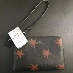 NWT Authentic Coach Wristlet Black and red stars. Perfect as a wallet. Brand new. Price on this is firm. Coach Bags Clutches & Wristlets
