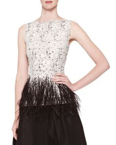 Carolina Herrera Sleeveless Lace Blouse with feathery hip area... she shows with wide legged Crepe Silk slacks. A stylish take on the current LACE trend.