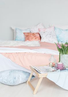 Lovely pastel cushions int pink and blue looks great in this bedroom. Minimalistic and scandinavian style. Lovely fresh summer look cushions for bedroom or living room.
