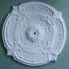 An ornate plaster ceiling rose with a chic French look, it has proved popular with customers renovating properties in France as well as in the UK. Plaster Ceiling Rose, Cornice Design, Pop Ceiling Design, Plaster Of Paris, Shabby Chic Style, Porcelain Vase, Pool Houses, Traditional Design, Decoration