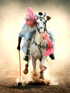 A native man known as a Sikh playing a traditional game, Hola Mohalla in Punjab, India.