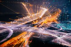 illuminated, night, long exposure, light trail, motion, city, blurred motion, transportation, speed, architecture, building exterior, built structure, traffic, road, city life, street, car, glowing, city street, land vehicle