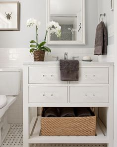 Lovejoy Designs- beautiful bathroom vanity. I love where the subway tile ends