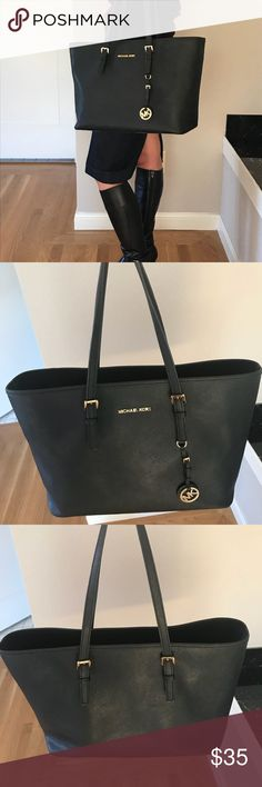 Michael Kors Jet Set Tote Michael Kors Jet Set Tote. Used and in good condition. Some wear and n handles as shown but functional and otherwise perfect. Priced to move. Michael Kors Bags Totes