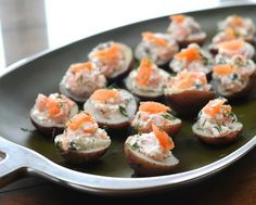 Potato Bites with Smoked Salmon, an easy appetizer with an elegant appearance, tiny potato halves stuffed with smoked salmon in a sour cream...