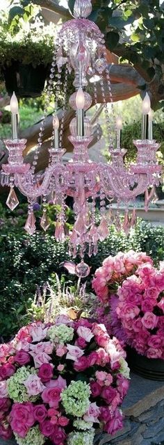 A pink chandelier cascading over gorgeous flowers...Simply Beautiful! #OutsideGardenParty #PrincessTeaParty