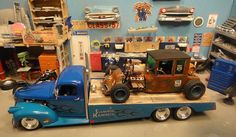 Revell '41 Chevy ramp truck using the '41 pickup. The ramp was built using thin plexiglass with the bed covered with real wood. On the back is the love it or hate it '25 tall T Rat Rod.