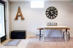 A gorgeous new plank wall brightens and totally transforms a previously, boring basement. - Littleouseoffour.com