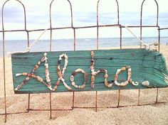 Seashell and barn wood sign  ALOHA script by mauiloot on Etsy, $40.00