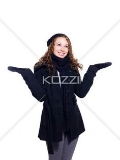young woman in winter clothing gesturing. - Young woman in winter clothing gesturing while standing over white background, Model: Brittany Beaudoin