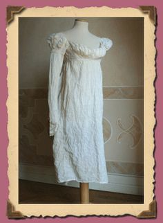 1806.. Whole dress in cotton muslin with lace inserts. The dress and 'missing of the left sleeve, some of which complemented the borders embroidered neckline and ruffle skirt terminal.