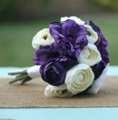 Purple and Ivory; Roses and Ranunculus.
