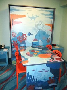 Each of the guestrooms in the Finding Nemo complex of Art of Animation Resort sleep up to six, by making use of hideaway beds next to the dining room table.