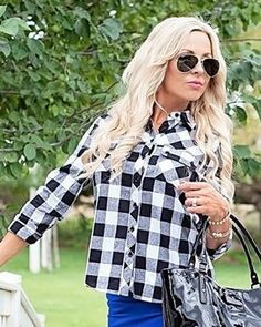 Everyone needs a black and white plaid shirt. They are a staple to any wardrobe. You can roll the sleeves on this top for a 3/4 sleeve look. The back of this top is pleated with a button detail. We have paired this top with our Royal Blue Midi Skirt and Open Toe Side Fringe Booties for a a perfect go to look!MATERIAL:This top runs true to size. Model is wearing a size small.