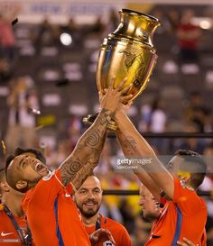 online store f7602 c8ddf Arturo Vidal of Chile and teammate Mauricio Isla hold the Copa America  Centenario Trophy following the championship match between Argentina and  Chile at ...