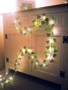 This is a beautiful Ivy leaf garland, made from silk leaves in two tones of green. All along the garland are tiny mirco LEDs in a warm white