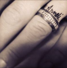 My love. He can't wear his wedding band at work for safety reasons, so he surprised me and got my name and our wedding date tattooed around his finger. <3