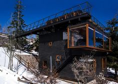 Los Canteros Mountain Refuge by dRN Arquitectos Farellones, Chile, completed in 2008. The property, made from steel, stone and wood spans an old void, bound on two sides by old containment walls bu...