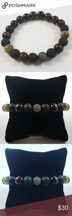 Men lava rock tiger eye cz ball beaded bracelet Men beaded bracelet. Fits most , 7.5 to 8.5 inch wrist. Handmade by me , never worn by anyone. Made with 10mm black lava rock / volcano beads , red tiger eye and honey tiger eye . Black rodhium plated and micro pave cubic zirconia ball charm .  I ship fast!!✈️Bundle and save !! ( 10 % off bundles) Any questions let me know ! No transactions outside Poshmark!! Accessories Jewelry