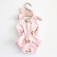 Image of pink rabbit pom playsuit