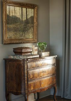 Barbara Westbrook vignette: Antique chest & books with marbleized pages, beautiful art