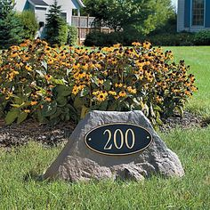 BOULDER ADDRESS SIGN. If you're looking to update your address numbers, you can mount them on a boulder in your landscape. Make it even better by putting a solar spotlight on it for visibility at night.