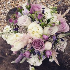 Bridal bouquet of cream peonies, lavender roses, lavender, oregano and astilbe. www.rose-cottage-flowers.co.uk