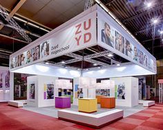 A colorful stand we built on an education fair for a school. Exhibition Booth, Booth Design, Showroom, Colorful, Education, School, Bed, Building, Furniture