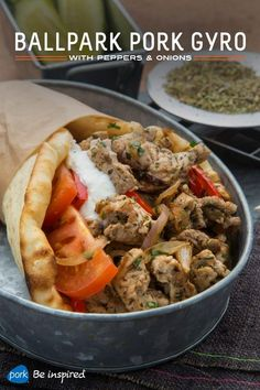 The classic sausage, peppers and onions dish meets gyro in this mashup featuring thinly sliced pork loin, onions and peppers in a marinade of olive oil, oregano, thyme and garlic. It's all wrapped up in a warm pita for easy game-time eating.
