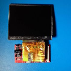 """Something we loved from Instagram! The #tft lcd display detached from all wires.  The 10v pinholes are on the bottom left.  The 5v pinholes are under the gold ribbon.  Next I will be soldering the usb  connection to the 5volt pinholes & hope that board modifications arn't required.  This 3.5"""" amazon lcd screen also has the same dimensions as the 3.5"""" adafruit lcd screen dow to the milimeter.  75mm X 65mm  #tftlcd #Adafruit  #Vaporbros  #vaporwarehouse  #Raspberrypicasemod  #Raspberrypilcd…"""