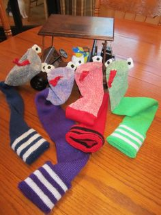 "Golf Head Covers...Soccer Sock Snakes for Utility Clubs and Putters  Head Covers and Golf Head Racks by Morgan and Lori @ ""Caddyshack Creative"" See ravelry.com Lorisav or visit Ferns GC in Markdale, ON."