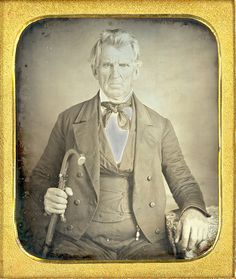Revolutionary War Survivor.    1/6 Plate daguerreotype of a senior gentleman and his cane. He very well may have been alive during the American Revolution. He is holding an unusual cane. Terrific lighting and clothes.