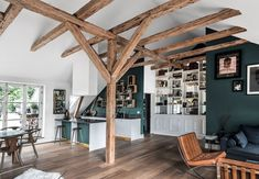 how to create a studio with a high ceiling in white and exposed wood frame, idea modern and traditional interior design with dark paint wall panel Source by archzinefr House, Interior, Home, Interior Architecture, Roof Styles, New Homes, Traditional Interior Design, Renovations, Interior Deco