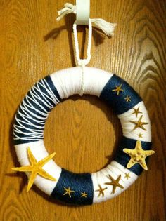Nautical Starfish Yarn Wreath by TheWrapperyIN on Etsy, $25.00