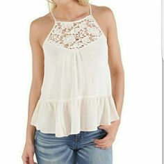 SALE NEW Racerback Lace Inset Tank Top Brand new with tags Color is a peachish cream. Cream Racerback Lace Inset Tank Top  SHOP WITH CONFIDENCE Top Rated Seller, Consistent 5 Star Ratings Reasonable Offers Are Welcome All Purchases Shipped Out within 1 Business Day No trades  PURCHASE 2 OR MORE ITEMS FROM MY CLOSET USING POSHMARK'S BUNDLE FEATURE AND RECEIVE 15% OFF YOUR ENTIRE BUNDLED ORDER Fashion on Earth Tops Tank Tops