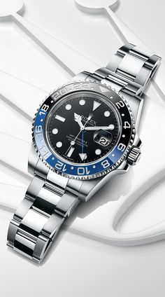 Rolex GMT-Master II in 904L steel with a 24-hour rotatable blue and black Cerachrom bezel in ceramic  a black dial and an Oyster bracelet.