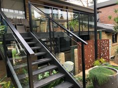 These glass balustrades not only look great, they ensure the stairs are safe - particularly important if you have children. #bettabalustrades #balustrades #landscaping #homeinspiration #centralcoastnsw #newcastle #sydney Glass Balustrade, Central Coast, Newcastle, Betta, Sydney, Landscaping, Stairs, Children, Home Decor