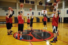 Players train their endurance by holding basketballs in the air at Whitman-Hanson High School boys' basketball practice on Friday, Feb. 12, 2016. — Marc Vasconcellos/The Enterprise