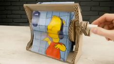 The Q channel demonstrates how to make a flipbook animation machine from cardboard. They used a scene from The Simpsons, featuring Bart, for reference. Diy Paper, Paper Art, Paper Crafts, Diy For Kids, Crafts For Kids, Diy And Crafts, Arts And Crafts, 21st Birthday Cards, Flipbook Animation