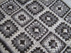 Handmade from pure wool in its natural colors, this granny square afghan is perfect for winter either as an upper blanket or as a bed cover. The 126