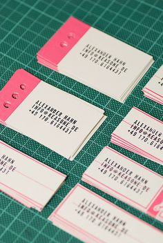 Hand stamped business cards in neon pink + white, by Alexander Hahn